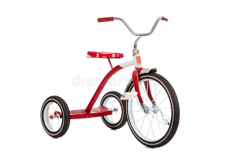 Triciclo rosso su bianco fotografie stock
