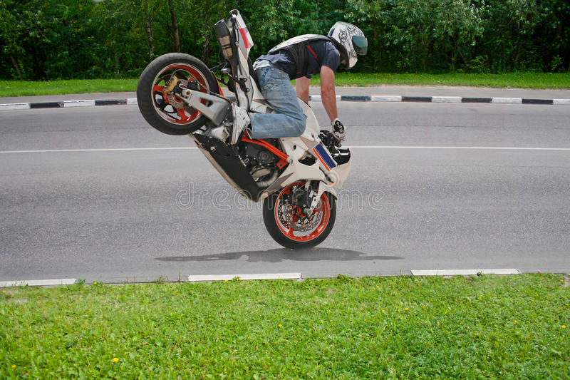 Trick on motorcycle stock image