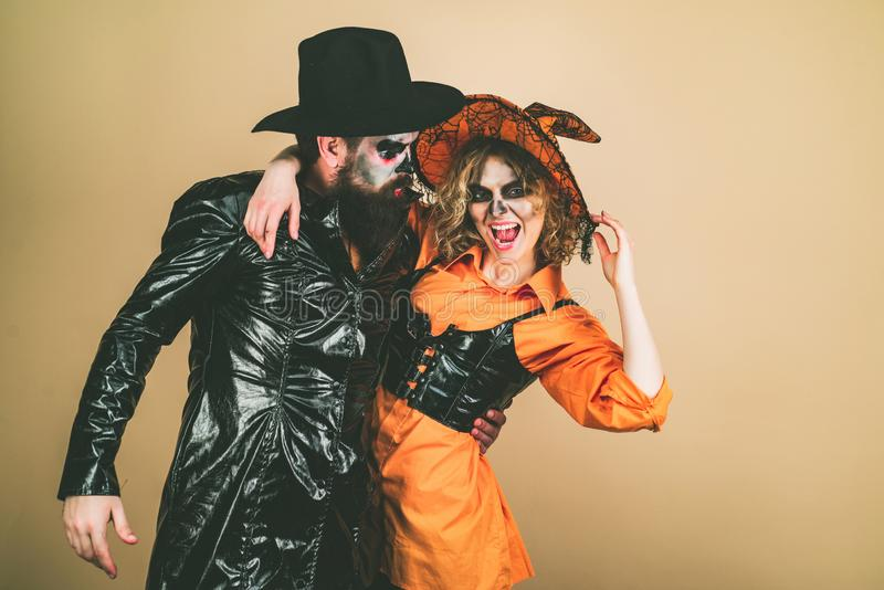 Trick or treat. Beautiful surprised woman in witch hat and costume - showing products. stock photography