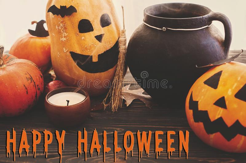 Trick or Treat bloody text, Happy Halloween. Pumpkins, jack-o-lantern, witch cauldron, bats, spider, candle, autumn leaves on. Black wood in light. Halloween stock photos