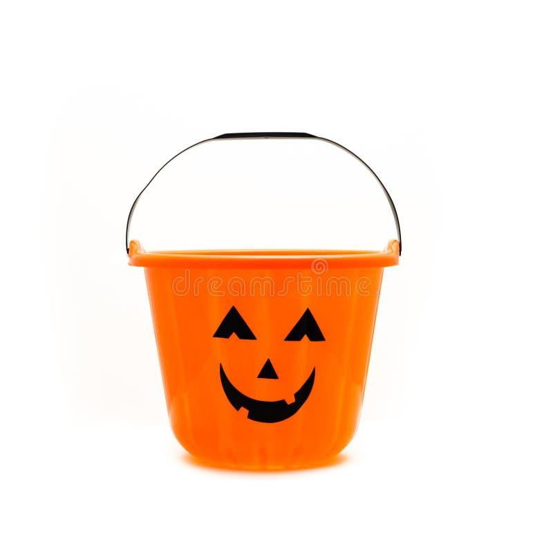 Trick Or Treat candy pail bucket isolated. Studio shot Jack O` Lantern Halloween candy bucket isolated on white background. Orange plastic Trick Or Treat candy stock image