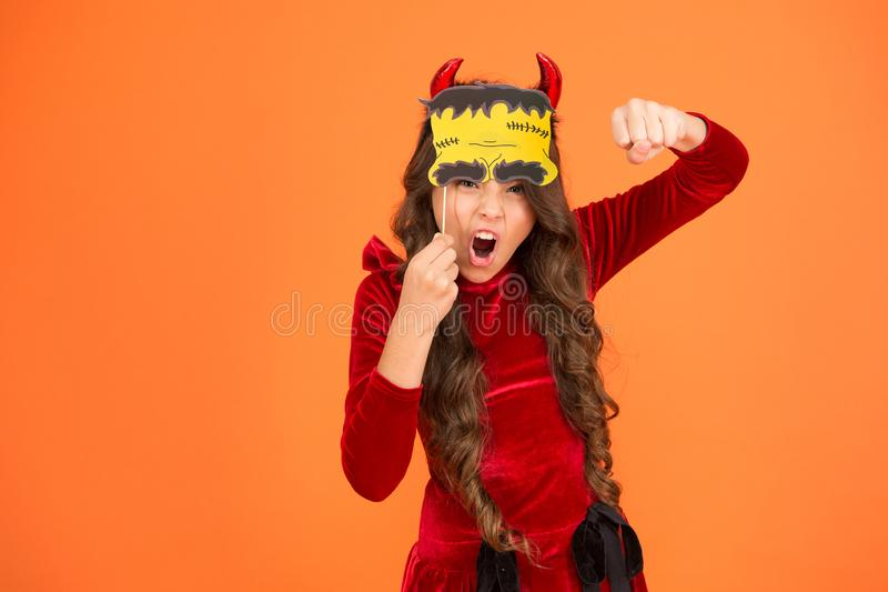 Trick or treat concept. Small child imp style accessory. Halloween party. Halloween costumes. Photo booth props. Autumn. Holiday. Little girl cute small horns royalty free stock images