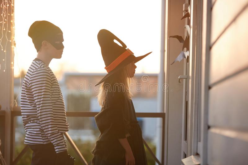 Trick or Treat Kids Waiting by Door on Halloween stock photography
