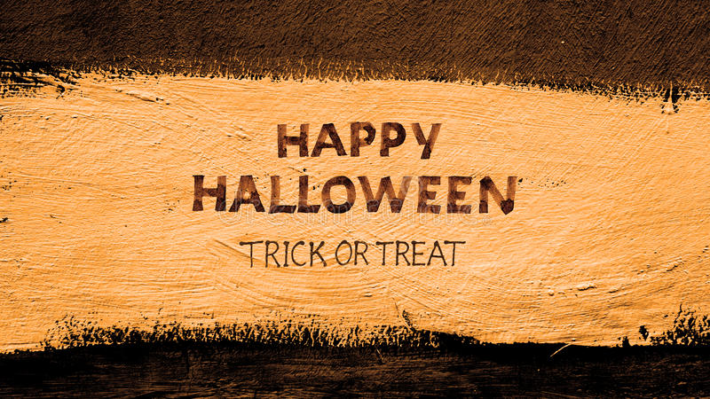 Trick or treat.typography halloween poster with calligraphy on the wall texture royalty free stock photo