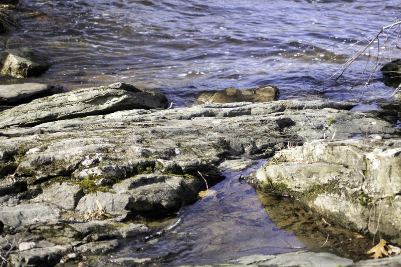Trickle. Water trickling through the rocks royalty free stock image
