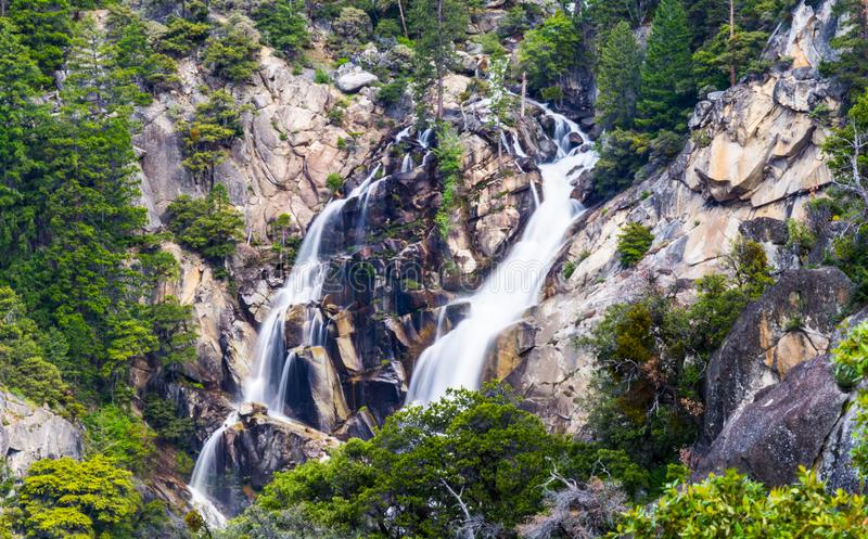 Trickling waterfall at Yosemite National Park. Smooth waterfall trickling down the sides of a mountain in multiple sections heading downward towards a stream stock photos
