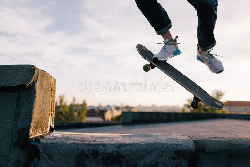 Tricks in skate park. Urban street style royalty free stock photos