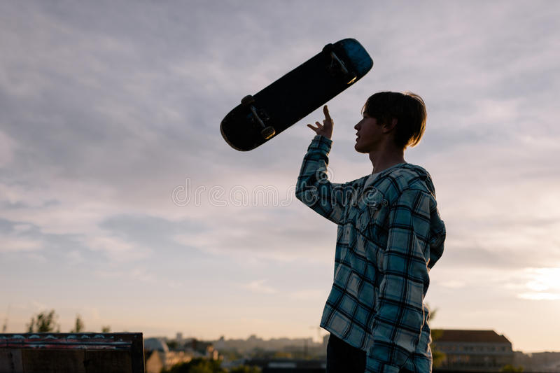 Tricks with skateboard. Extreme for young people stock images