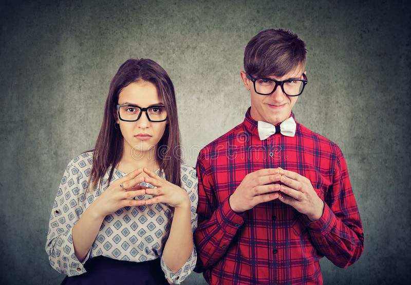 Tricky couple planning revenge together royalty free stock images