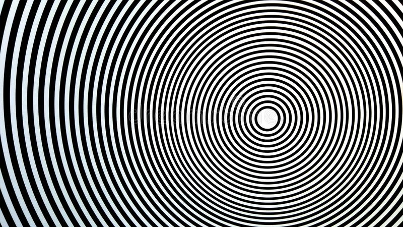 Tricky optical game which seems moving. Circles on circles, center, target of something or bull`s eye. Circumferences in black and white colors stock photo