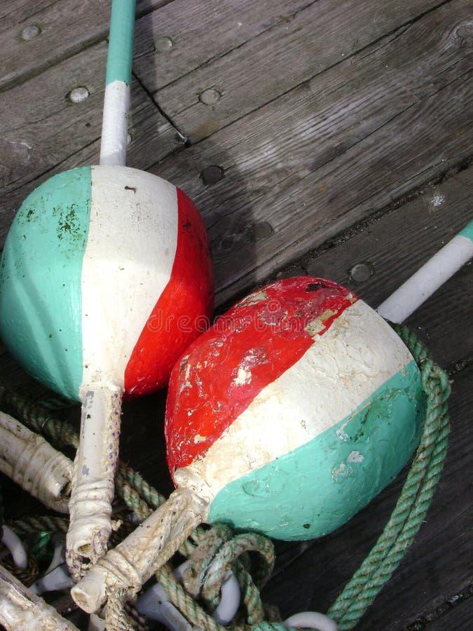 Tricolor Bojen stockfotos