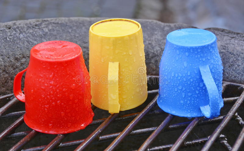 Tricolor cups. Cups with the colors of Romania, at water fountain stock image