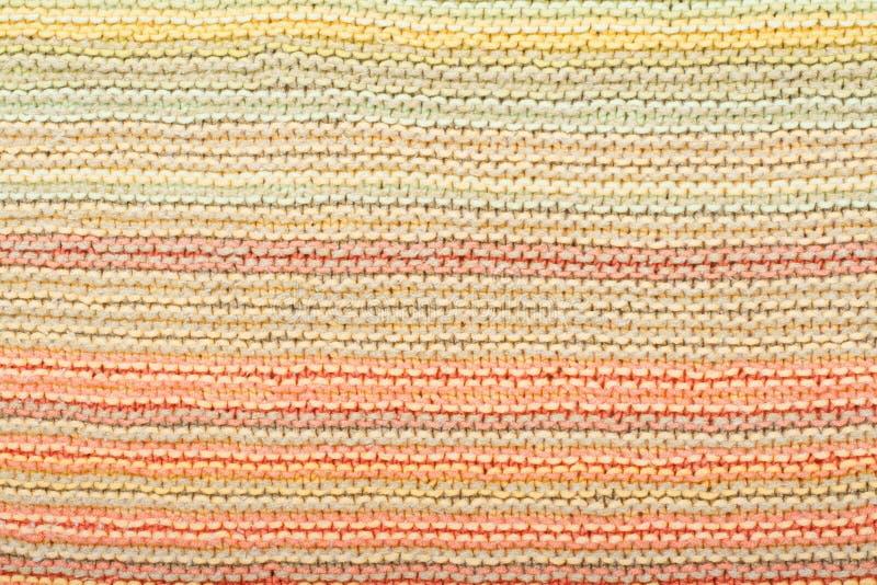 Tricottare di struttura del tessuto della sciarpa o del maglione grande Fondo tricottato del jersey con un modello in rilievo Mac immagine stock