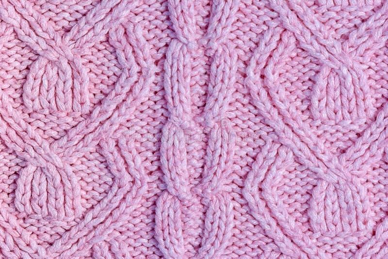 Tricottare rosa con il primo piano dei nastri Fondo in bianco per le disposizioni con struttura tricottata fotografia stock