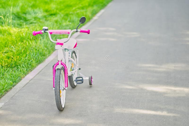 Tricycle on bicycle path in the park. stock photos