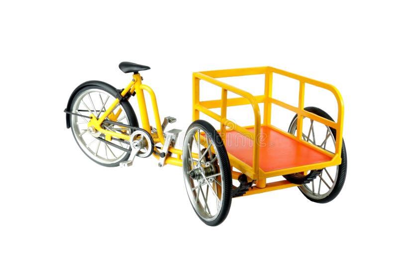 Tricycle de transporteur sur le blanc image stock