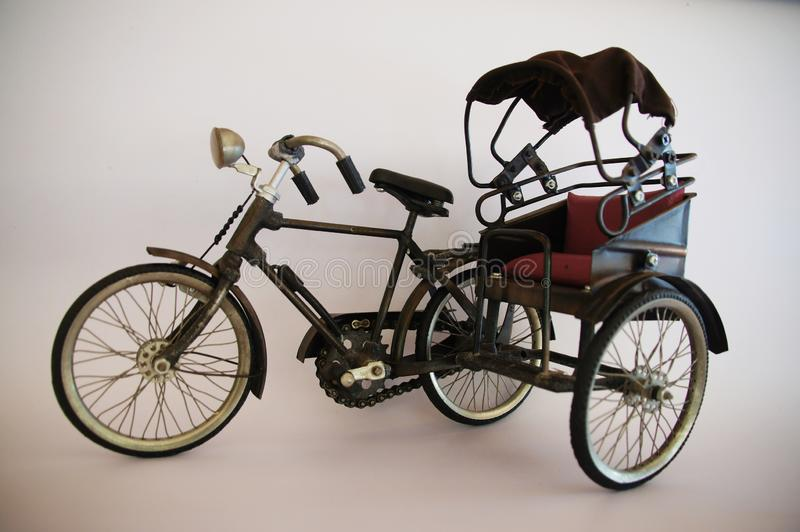 The tricycle model in the olden days was made of steel and fabric. royalty free stock photos