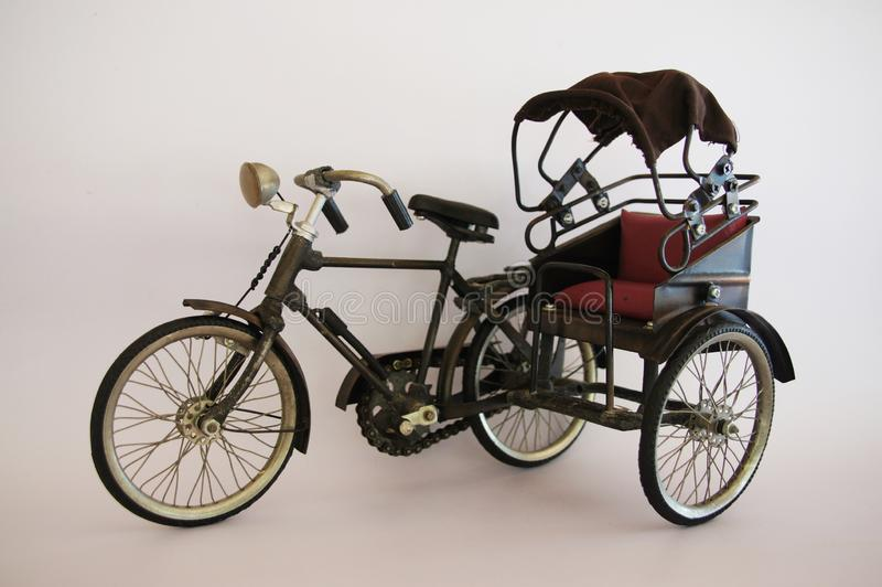 The tricycle model in the olden days was made of steel and fabric. The tricycle model in the olden days was made of steel material and beautiful cloth stock image