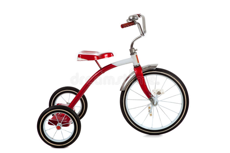 Tricycle rouge sur le blanc photo stock