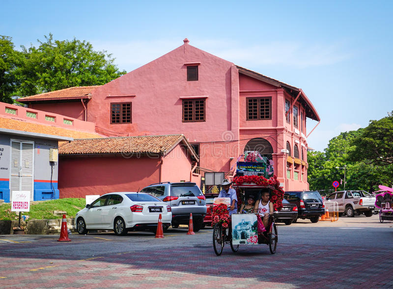 A tricycle running on street in Malacca City, Malaysia royalty free stock photo