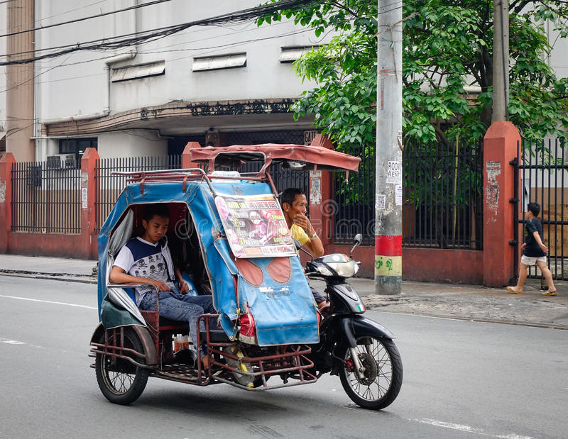 A tricycle running on street in Manila, Philippines royalty free stock images