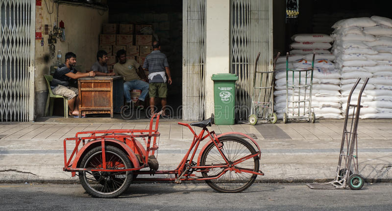 Tricycle on street in Kuala Lumpur, Malaysia royalty free stock images
