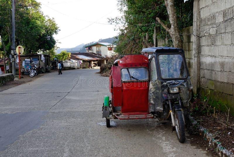 Tricycle sur la rue dans Ifugao, Philippines images libres de droits