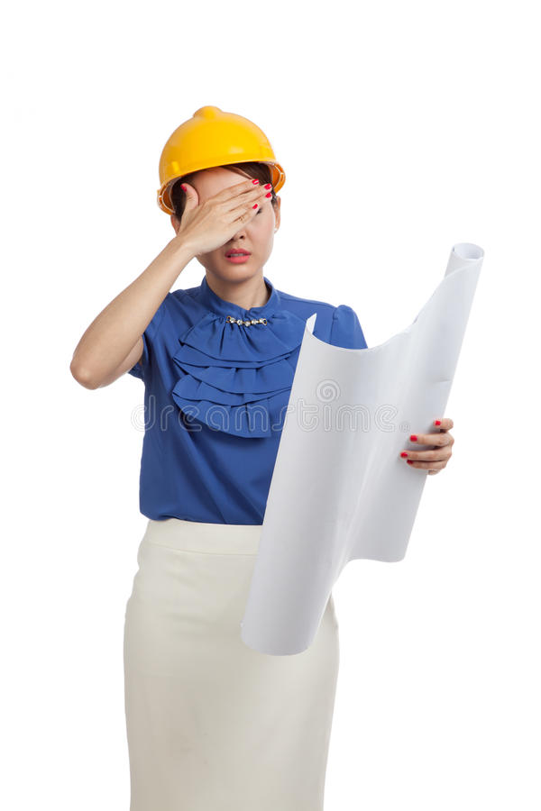 Tried Asian engineer woman with blueprints stock photos
