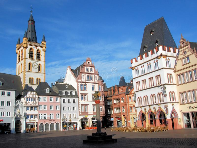 Trier, Hauptmarkt, square with half-timbered houses and church. Trier, Hauptmarkt, town square with beautiful colored half-timbered houses and church, Germany stock photo