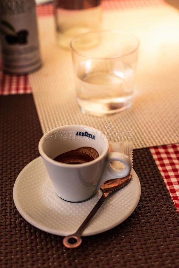 Free Trieste, Italy - September 2019: Lavazza Espresso Cup With Spoon And Cookie On A Table On A Warm Summer Day In An Italian Street. Stock Photos - 166957823