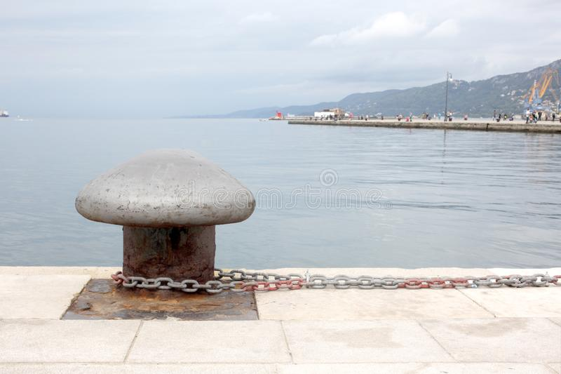 Trieste, September 5 2017, Italy: anchorage point at a stone pier. Trieste, September 5 2017, Italy: anchorage point on a stone pier stock image