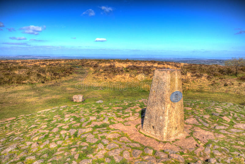 Trig point at Black Down the highest hill in the Mendip Hills Somerset in south-west England UK in colourful HDR. Trig point at Black Down the highest hill in royalty free stock images