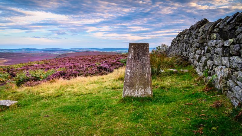 Trig Point on Ros Hill. Ros Hill also known as Ros Castle due to an ancient prehistoric Hillfort on its summit is located near Chillingham in Northumberland and royalty free stock photography