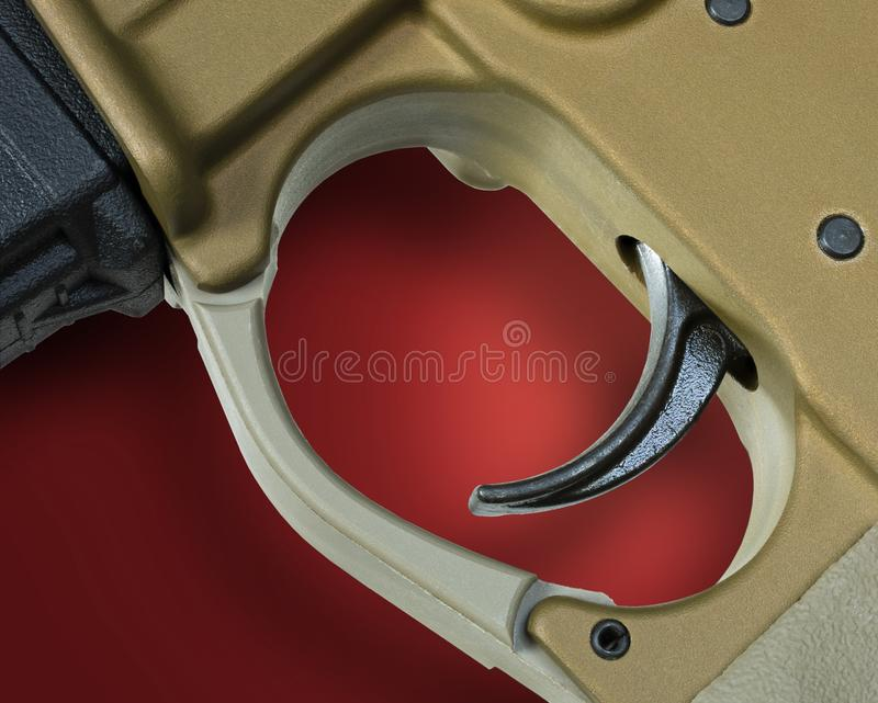 AR-15 trigger with red and shadow behind stock photography