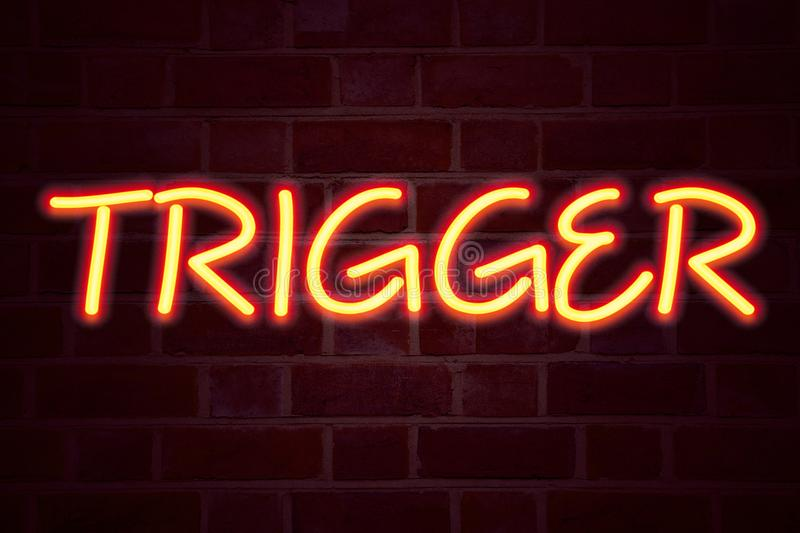 Trigger neon sign on brick wall background. Fluorescent Neon tube Sign on brickwork Business concept for Stir Spark Loose or Unlea. Sh Idea 3D rendered Front royalty free stock photo