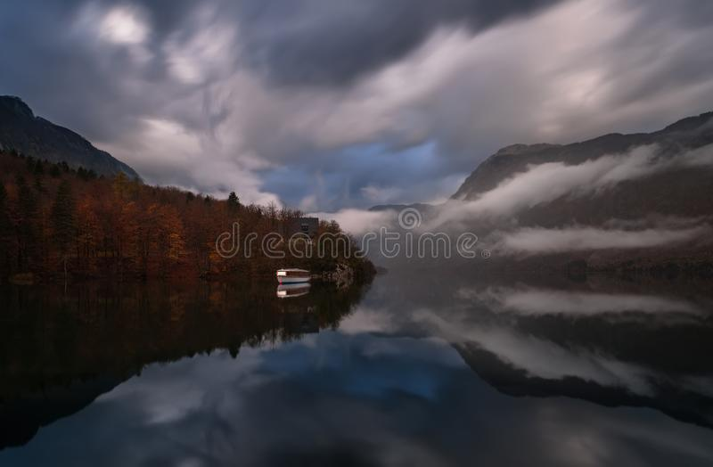 Triglav National Park, Slovenia, Largest Glacial Bohinj Lake  Bohinjsko Jezero Or Wocheiner See .Unusual Clouds In Form Of Finge. Rs During Flood Time In stock photography