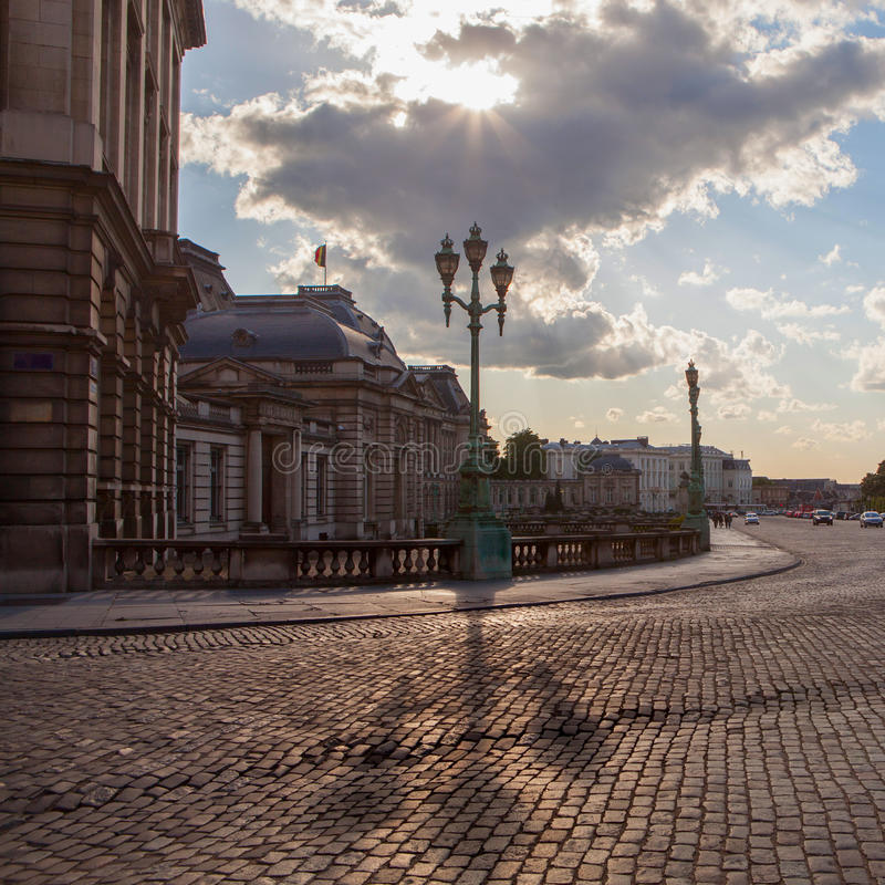 Trihead lamps and copper street in place royale. Bruxelles, Belgium royalty free stock photography