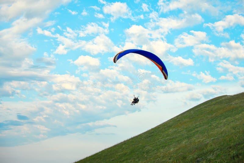 Trike with a parachute against the blue sky. stock photos
