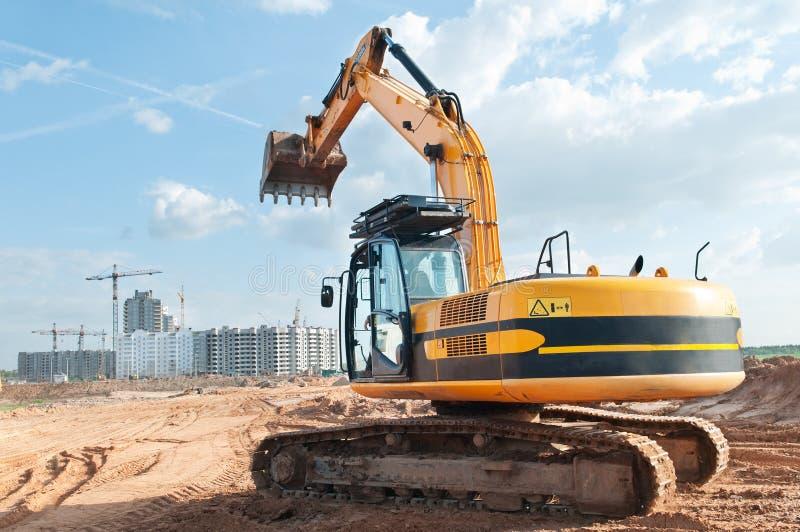 Trilha-tipo máquina escavadora do carregador em imagem de stock royalty free