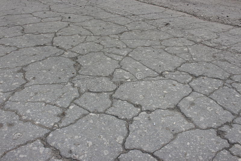 A trilha velha do asfalto foto de stock