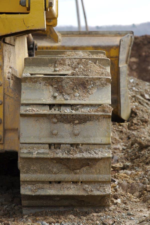 Trilhas da escavadora ou da maquinaria fotografia de stock royalty free