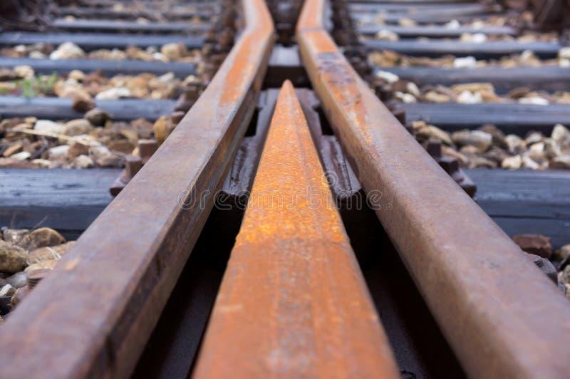 Trilhas railway velhas em uma junção fotografia de stock