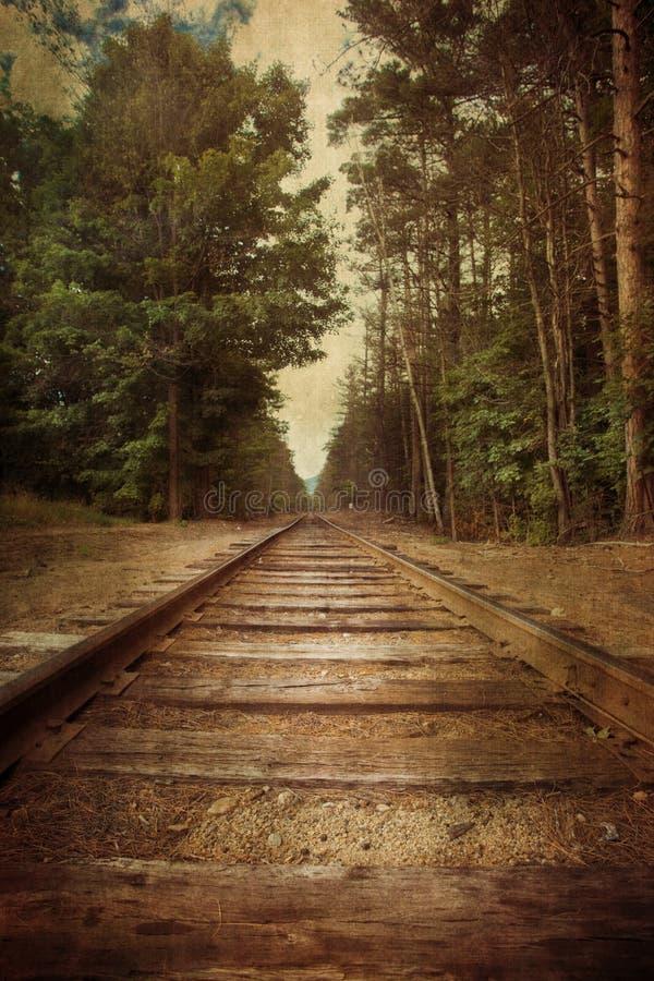 Trilhas retros do trem do estilo fotografia de stock