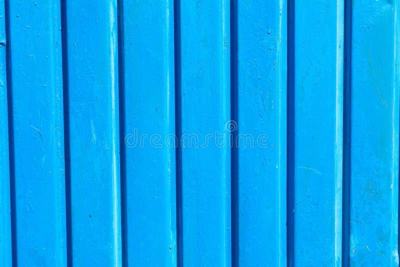 Trillende blauwe houten planking achtergrond met barsten stock fotografie