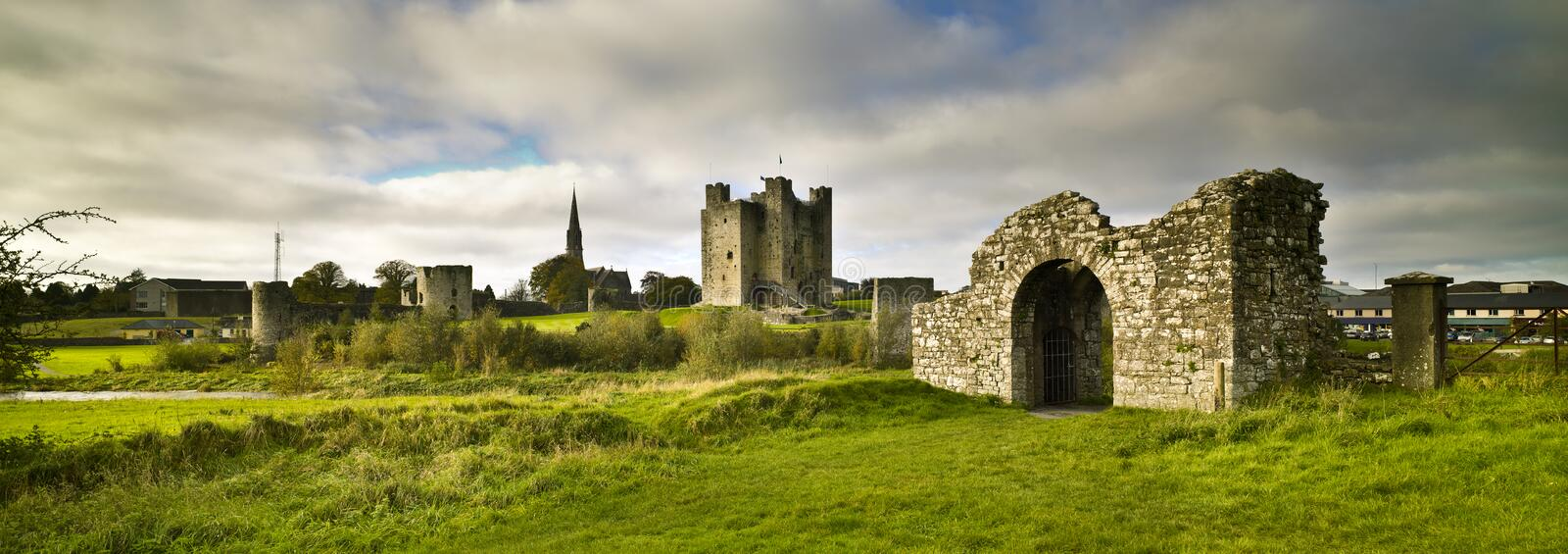 Trim Castle Trim, County Meath, Ireland. Morning. Trim Castle Trim, County Meath, Ireland. Green grass and cloudy sky. Morning stock images