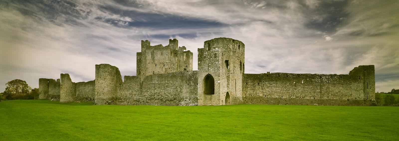 Trim Castle Trim, County Meath, Ireland. Green grass and cloudy sky. Morning stock photos