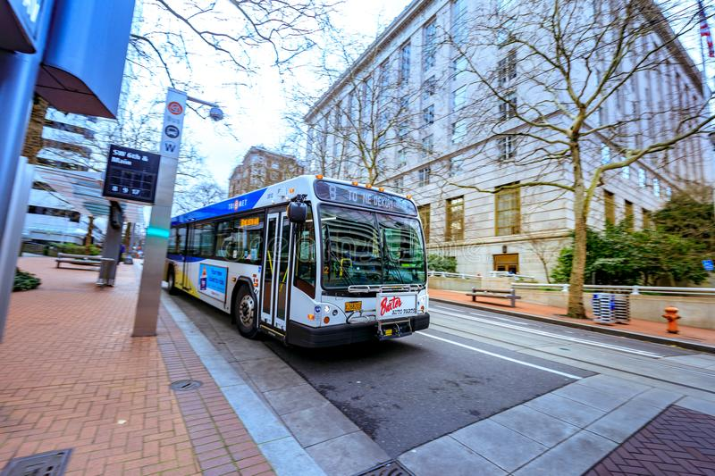 TriMet bus station in front of United States Court House building in downtown Portland. Portland, Oregon, United States - Dec 19, 2017: TriMet bus station in stock photography
