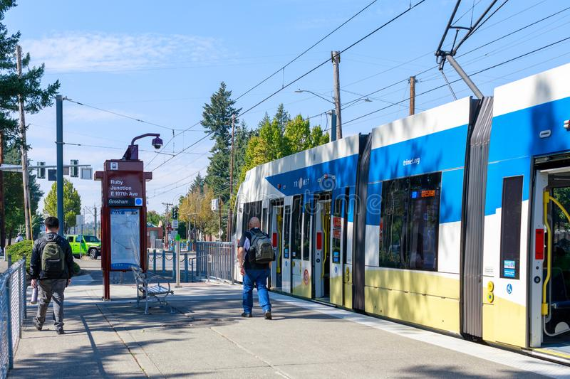 A Trimet light rail train heading through a city near Ruby Junction MAX station, Oregon royalty free stock photos