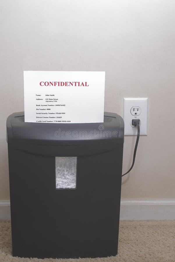 Trinciatrice - concetto di furto di identità immagini stock