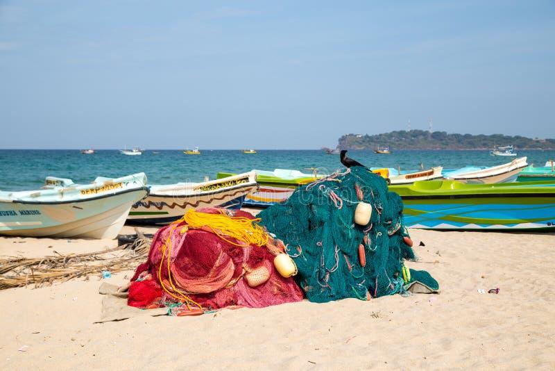 Fishing boats at Trincomalee Beach, Sri Lanka stock photography